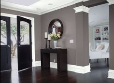 love the gray walls with white trim and dark hardwood floors