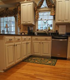 Refinishing cabinets makes them look fresh and new for a fraction of the cost to replace them with new cabinets.  If doors and drawers are in great shape then update them with a refinished paint look!