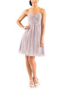 DescriptionJenny Yoo WrenCocktail length bridesmaid dressStrapless, pleated sweetheart necklineNatural waistConvertible style with long tulle panelsSoft TulleLongThis fun strapless cocktail length bridesmaid dress is made from soft tulle and features a gorgeous pleated sweetheart bodice. Long panels allow the dress to be worn a multitude of different ways by different wrapping options around the bodice. - mink grey, vintage lilac, lilac colors