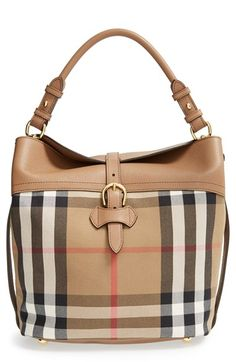 Free shipping and returns on Burberry 'Medium Sycamore' House Check & Leather Hobo at Nordstrom.com. The crisp lines of Burberry's House check add structure to the slouchy attitude of the Sycamore hobo bag, while grainy leather trim, equestrian-inspired detailing and hand-painted edges add polish. A deep interior provides ample space for all your fashionable essentials and the rolled top handle is perfect for over-the-shoulder wear or carrying on the arm.