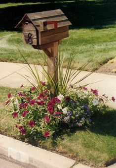 I love this mailbox, and I love the flower bed around it.