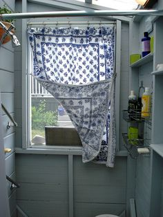 This is exactly what I need to do about the bare window in my laundry room. Simple clips and some cool fabric. from Amy Bradstreet on Flickr.