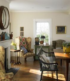 i love the farm table with the black bench, hardwood floors and color palette.