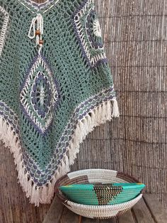 Bo-M So many beautiful ponchos and fringed shawls. Great colour combinations!
