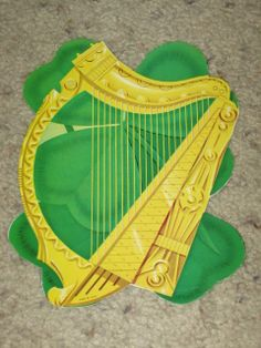 "1960 Eureka 'Harp And Shamrock' Die Cut Decoration. Three Sizes: 4"", 7 1/2"", 12"""