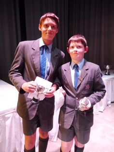 Murray and Bruce holding their school trophies. (December 2013)