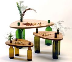 Easy diy-reuse idea. Tables from bottles.See more  http://www.recyclart.org/2015/08/side-tables-made-reused-bottles-wood-tati-guimaraes/