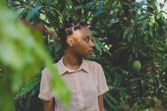Deep in a mango (Julie) tree with @kesikhmet  #trinidad #trinidadandtobago #mango #caribbean #tree #backyard #natural #naturelover #portrait #portraitphotographer #hipster #green #beauty #tropics #model #fruit #naturalhair #naturalista #bantuknots #blackwoman #talent