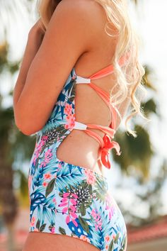 Twist & Tie your swimsuit any way you want it! Modest one piece swimsuit in bright hawaiian print! Bev Swim