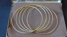 5 anillos para el cuello en bronce.