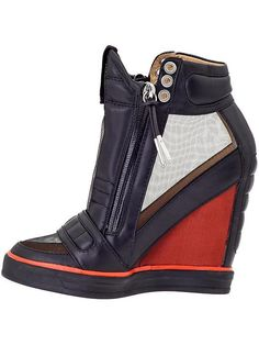 L.A.M.B. Stephanie Wedge Sneaker ugly but in a cool kinda way.. enough for me to actually wear them