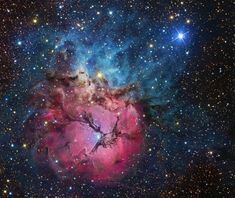 A Beautiful Trifid  Image Credit & Copyright: R Jay Gabany    The beautiful Trifid Nebula is a cosmic study... aka M20, it lies about 5,000 LYrs away 2ward the nebula rich constellation Sagittarius. A star forming region in the plane of r galaxy, the Trifid illustrates 3 diff types of astronomical nebulae; red emission nebulae dominated by light emitted by hydrogen atoms, blue reflection nebulae produced by dust reflecting starlight, and dark nebulae where dense dust clouds appear in silhoue...
