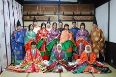 Men and women dressed in heian robes at a kimono photography experience.