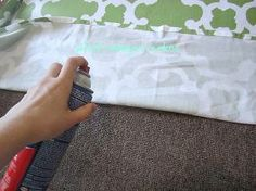 a shower curtain rug, home decor, reupholster, window treatments, Using an adhesive spray attach an IRONED FABRIC shower curtain to the rug Smoothing it out as you go