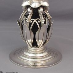 A pair of sterling silver candelabra by Georg Jensen, made in Copenhagen in 1921.