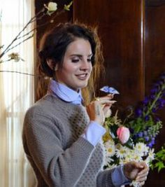 Flores. Lana Del Rey at a flowery photoshoot