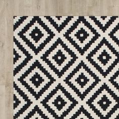 Add a pop of pattern to the foyer or tie together your living room seating group with this chic rug, showcasing a stylish diamond motif.