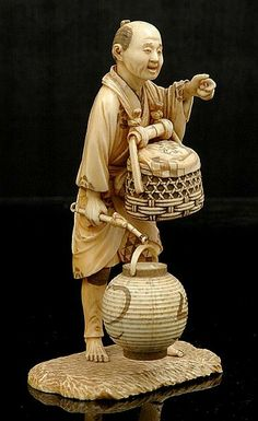 A Japanese ivory okimono of a lantern Salesman Meiji period 1868- 1912, the standing figure modelled holding a lantern in his right hand and a basket strapped to his front signed lacquer tablet to base. Height 15 cm.