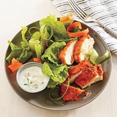We gussied up the classic appetizer and transformed it into a healthy entrée salad of saucy chicken strips, crisp carrots and celery, and pungent buttermilk--blue cheese dressing. You can drizzle the dressing over the salad or serve alongside for dipping. Serve with toasted French bread baguette slices for a more filling meal.