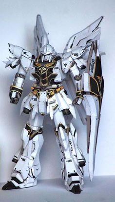 This gundam paper model is a White Comet Sinanju (aka Sinanju, recolored and retouched by Suprayogi, based on Julius Perdana& template. Gundam Papercraft, Zoids, Armadura Cosplay, Papercraft Download, Paper Art, Paper Crafts, 3d Cnc, Aztec Art, Wedding Tattoos