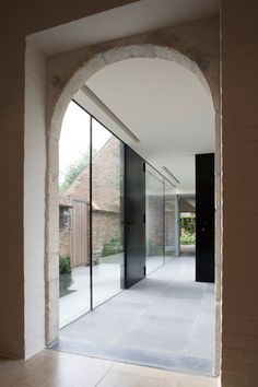 House GL by Architectslab - Brussels. A glass passage links the spaces of the existing 1970's country house.