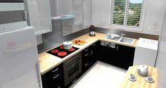 Petite cuisine équipée avec l'évier sous la fenêtre
