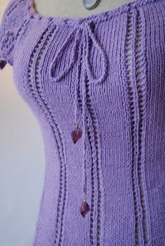 Knitting - such a cute little sweater... wish I could knit...