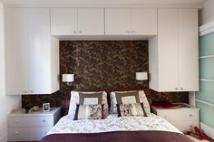 Vivid Small Bedroom Designs - cabinets mounted above the bed with lighting provide additional storage in this very small space. Description from pinterest.com. I searched for this on bing.com/images