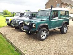 3 Land Rover's waiting
