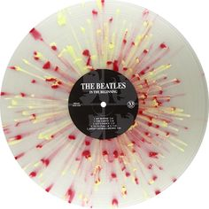 In The Beginning, Album by The Beatles. Collector's edition. Limited to 1000 copies on multicolor, red and yellow on clear splattered vinyl. Collection of unusual, rare vinyl and unique colored collectible records.