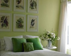 Lovely pale green bedroom color scheme! Fresh white flowers, white bedding and sheer white curtains create a definite spring vibe. The bird wall art completes the concept.