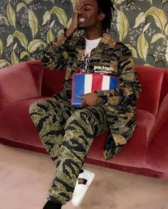Playboi Carti Wears Palm Angels Camo Jacket, Supreme x Champion Pants, Gucci Sneakers and Balenciaga Bag | UpscaleHype