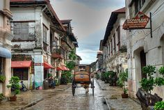Established in the century, Vigan is a lovingly preserved example of a Spanish colonial town that wouldn't seem out of place in the wilds of Andalucia. It survived WWII intact and today is a UNESCO World Heritage Site. Vigan Philippines, Philippines Travel, Philippine Architecture, Places To Travel, Places To Visit, Mindoro, Ilocos, Philippines Culture, Filipino Culture