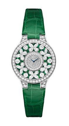 Graff Emerald Butterfly Watch in white gold, set with 335 diamonds, 78 emeralds and 22 diamonds on the buckle, and fastened with a green crocodile strap.