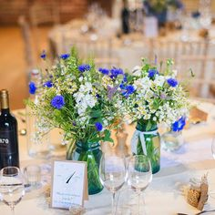 At Gaynes Park wild flowers in jam jars are used as rustic wedding table centrepieces jamjarflowers Wedding Table Flowers, Wedding Table Centerpieces, Flower Centerpieces, Rustic Wedding Tables, Wild Flower Wedding, Bohemian Wedding Flowers, Centerpiece Ideas, Flower Table Decorations, Wedding Decorations