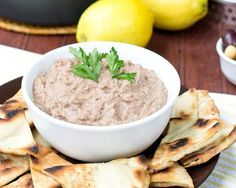 This classic from-scratch hummus recipe gets a blast of rich salty flavor from kalamata olives and freshness from parsley. The pita chips are quickly toasted in a skillet so that you can make them anytime, even on short notice.   more