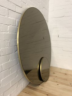 Bespoke round mirrors from dia. 40cm to 120cm. Bespoke mirror tint: black, bronze, silver, blue and green. Frame finish: brass, brass patina, black, white, green, red, yellow, green and bespoke colours. Contact us for a bespoke mirror.  #tintedmirror #mirrortint #bronzemirror