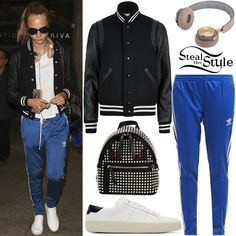 Cara Delevingne was spotted arriving at LAX Airport wearing a Saint Laurent Classic Teddy Leather-Sleeve Jacket ($2,590.00), Adidas Originals Supergirl Track Pants ($47.99), Fendi Monster Studded Backpack (Sold Out), BeoPlay H8 Headphones ($429.00) and Saint Laurent Court Classic Sneakers ($545.00).