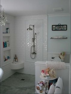 Beveled Subway Tile in Herringbone Pattern. I also love the idea of crystal chandelier in a bathroom with mint blue walls