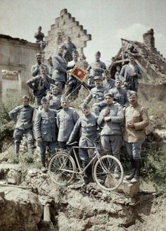 French officers of the 370th Infantry Regiment pose in the ruins after a German attack at the Chemin des Dames near Reims in 1917. They have a bicycle and the flag of the 370th Infantry Regiment. The region was one of the worst battle grounds on the Western Front during World War I.
