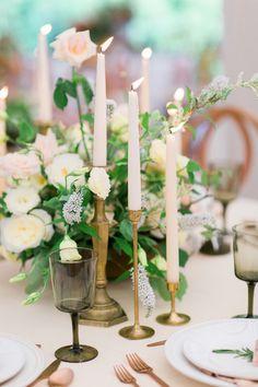 candlestick centerpieces - photo by Kivalo Photography http://ruffledblog.com/herbes-de-provence-wedding-inspiration
