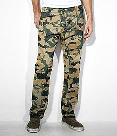 $42, Olive Camouflage Chinos: Levi's Chino Pants. Sold by Dillard's. Click for more info: https://lookastic.com/men/shop_items/82588/redirect