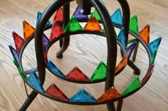 """Challenge children to find places around the home/classroom that Magna-Tiles magically """"stick"""" to!"""