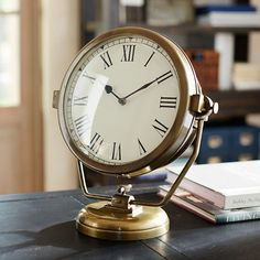 This Ships #Clock has a fetching retro look with a brass finish and large dial with metal hands and Roman numerals that makes it seem like a #vintage design.