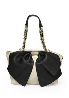 The Bow Transforms This Ordinary Handbag Into A Standout Stunner