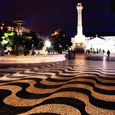 Beautiful town squares in Lisbon, Portugal. The sidewalks and squares have many different black & white tile mosaic designs