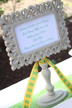 neat idea for table decoration for special events. get a picture frame and candle stand and glue together.