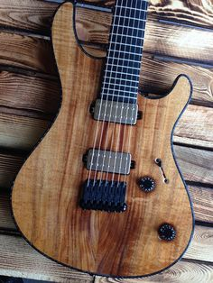 "Mayones Regius 7 Custom Shop, Koa top, Trans Natural Gloss finish, Black Limba (Korina) body wings, 11-ply neck-thru-body section (Hard Rock Maple, Mahogany, Wenge, Amazakoe), Trans Natural Matte back finish, Ebony fingerboard, 16"" Radius, 24 Ferd Wagner medium jumbo frets, 25.4"" scale, only side dot markers, 3-ply Black ABS / Black acrylic binding, Bare Knuckle Pickups Aftermath calibrated set with Brushed Nickel covers"