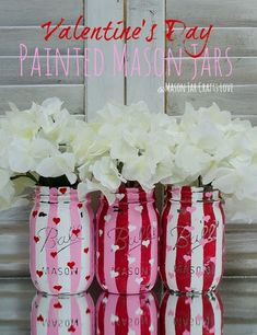 Hello...I love you.  Mason jars with pin stripes in red, white, and pink floating flowers.  Yes.  Merry Makery.