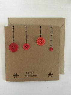 Button bauble Christmas card. Sweet & simple! The card can be personalised by adding a name or any other text. Please write this in the notes section when ordering. The button baubles are either red or green or mixed. Size of card 6in X 6in. Comes with a matching plain envelope.